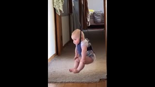 Baby Lifts Her Legs Up While Sitting In Her Bouncer