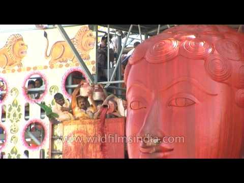 Sindur or red vermillion being poured onto Shravanabelagola