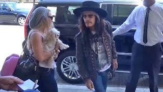 Steven Tyler Catches Flight With Pup And Mystery Blonde