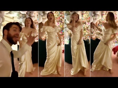 Miley Cyrus dances to 'Uptown Funk' in gorgeous wedding gown with husband Mp3