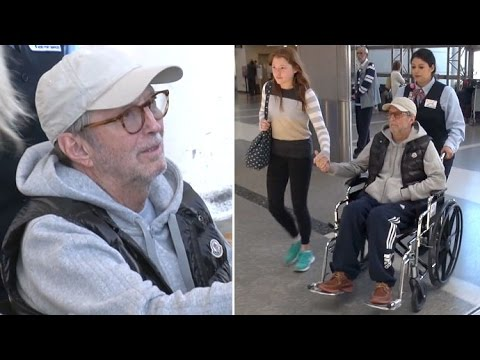 Eric Clapton In A Wheelchair At LAX After Canceling Shows Due To