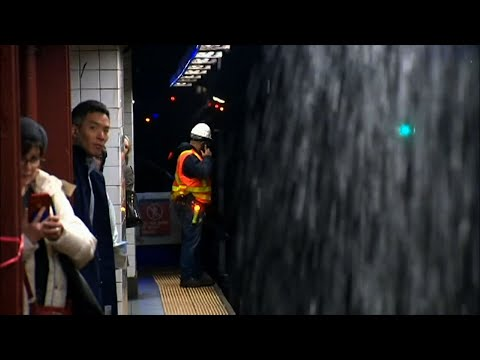 Raw: Rainstorm Floods New York Subways