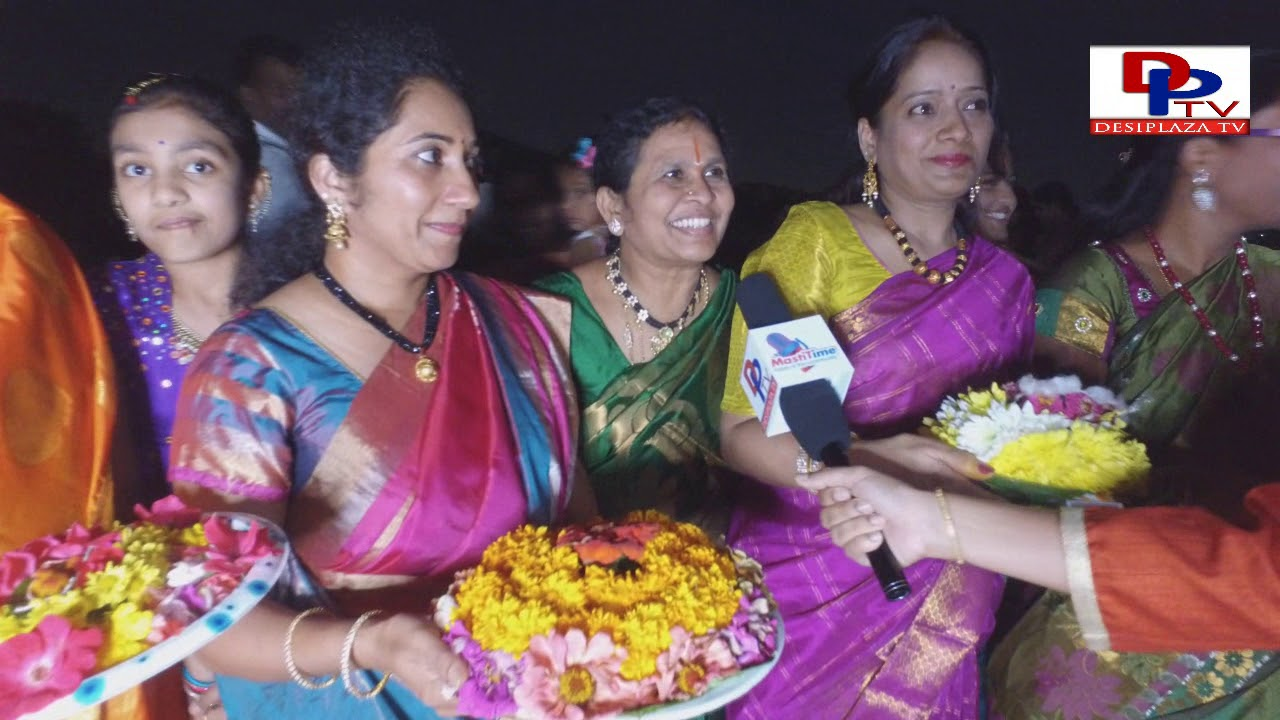 Ladies showing their bathukamma  at DATA (Dallas Area Telangana Assocation) INGILI PUVULA BATHUKAMMA