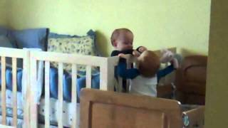 Twin Baby Boys Play Crib Volleyball