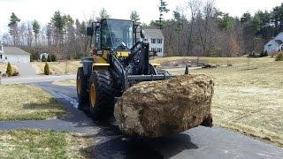 Wheel Loader Loading Big Boulders Into Dump Trucks