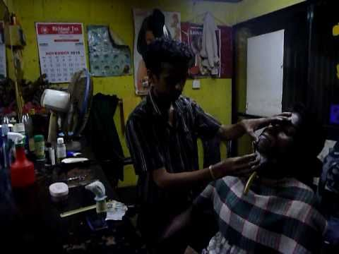 Sri Lanka,ශ්රී ලංකා,Ceylon,Galle,Barber shaving a client