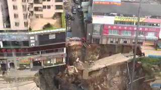 Subway construction site in China collapses suddenly into humongous sinkhole.