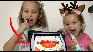 Детская игра которая поможет детям чистить зубы Мила и Ника тестируют полезный подарок детскийблог