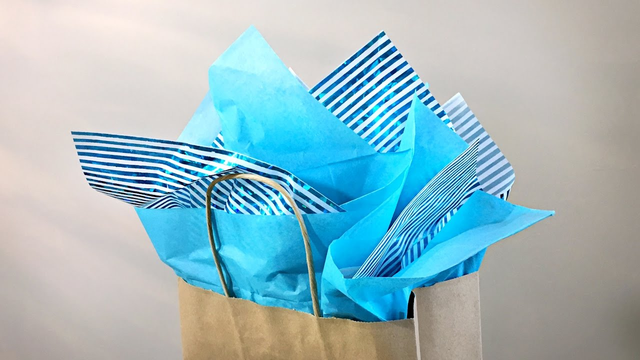 How to put tissue in a gift bag gift wrapping tutorial for How to wrap presents with wrapping paper