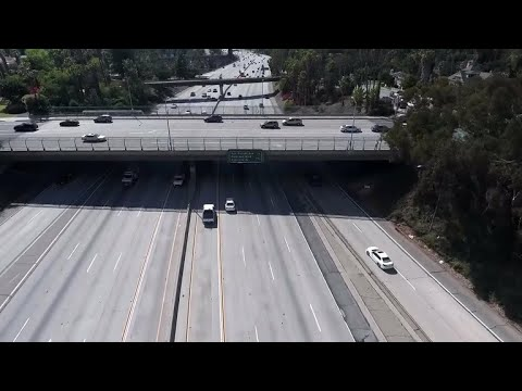 Boulder pushed off California overpass kills man in car