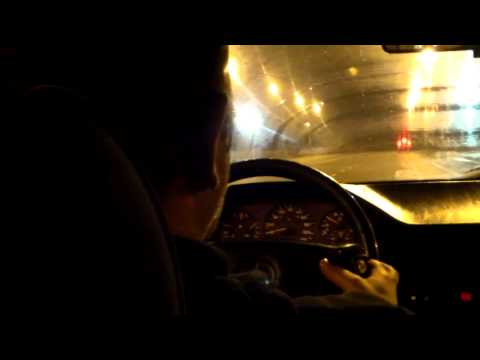 Taxi driver in Tbilisi speaks on phone and eats sunflower seeds