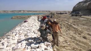 Historic scene in the new Suez Canal from four workers