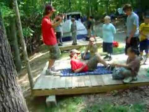 Boy Scouts demonstrate building a stretcher