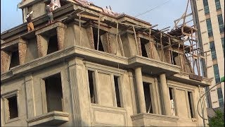 House Construction In Progress - Workers Make Very Neat Cornices