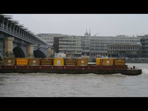 Thames Tug Regain towing rubbish barges in London