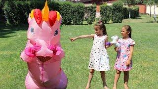Masha plaing with big unicorn toys