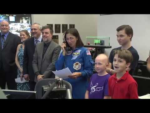 """Space Station Crew Unveils """"Space Suit"""" Designed by Cancer Patients on Earth"""