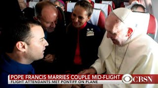 Pope Francis marries couple mid-flight