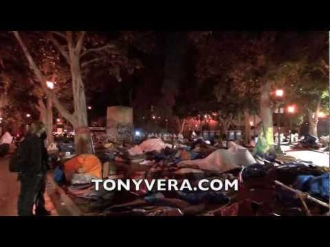 Occupy L.A. protesters@ City Hall Park 11/30/11 run to a church for help after LAPD evict them