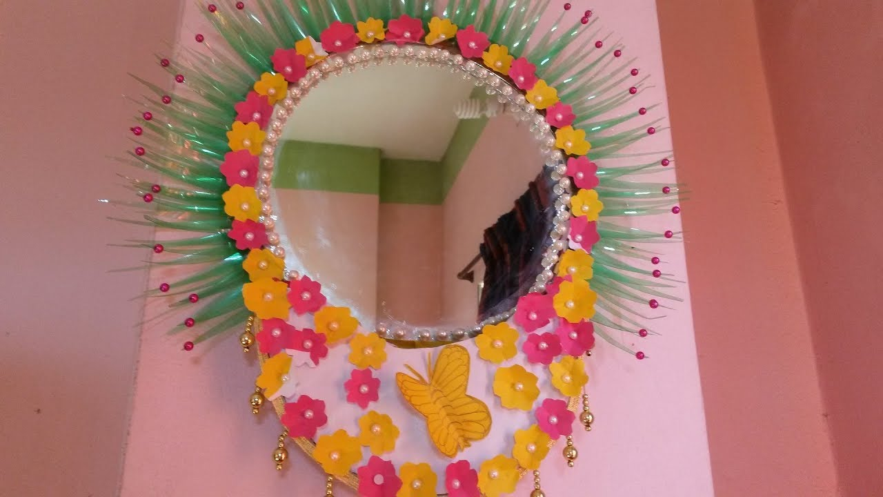 Recycled bottles crafts how to make wall hanging using for Recycled room decoration crafts