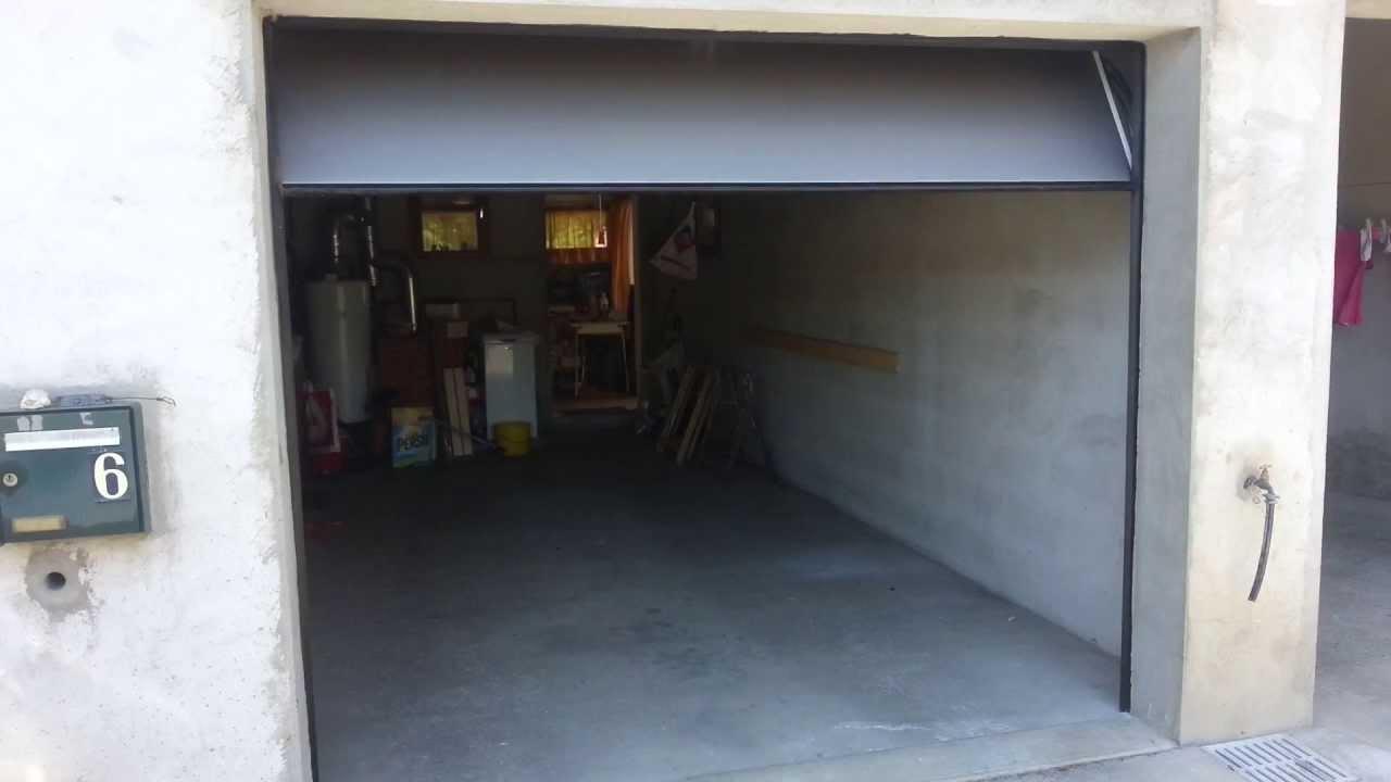 Porte de Garage Sectionnelle Motorisé Grise posé à Lavernose