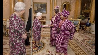 Queen Elizabeth II sees the funny side of fashion clash at Buckingham Palace