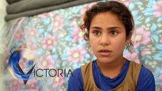 The families living inside the battle for Mosul - BBC News