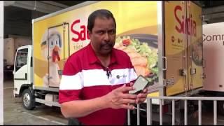 Mr Thavabala Krishnan demonstrating the transportation management system app (TMS)