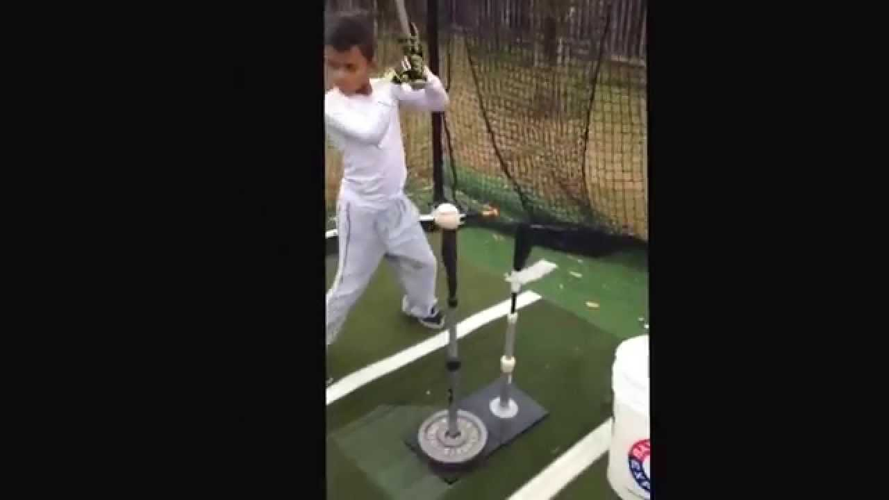 kayson cunningham 8 year old in the the backyard batting cage