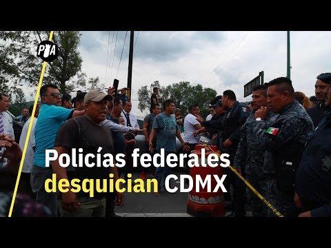 Policías federales contra la Guardia Nacional