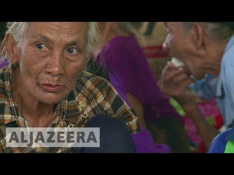 Struggle to coax many to leave Bali volcano danger zone