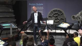 Jeff Bezos speaks with students at the opening of the Apollo exhibit at The Museum of Flight