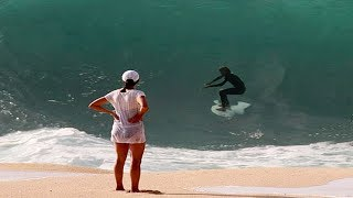 Surfers Attempt to Ride Waves Dangerously Close to the Beach on Tiny Surboards
