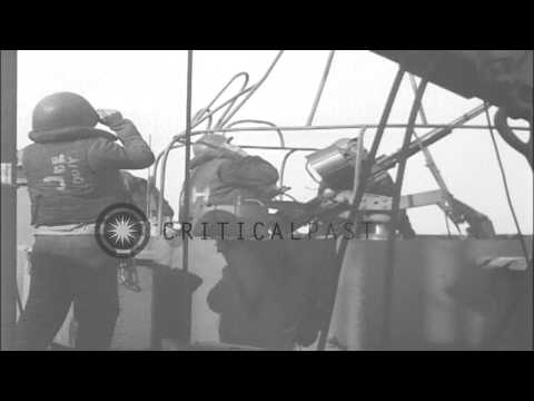 German aircraft drop bombs on a fleet of ships in Anzio Harbor, Italy during Oper...HD Stock Footage