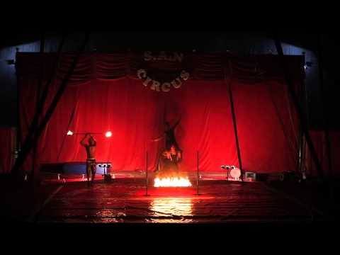 MALAWIAN CIRCUS ARTIST FIRE DANCER, ,FIRE BREATHER AND THE SILK WORKSHOP PERFORMING FIRE LIMBO.