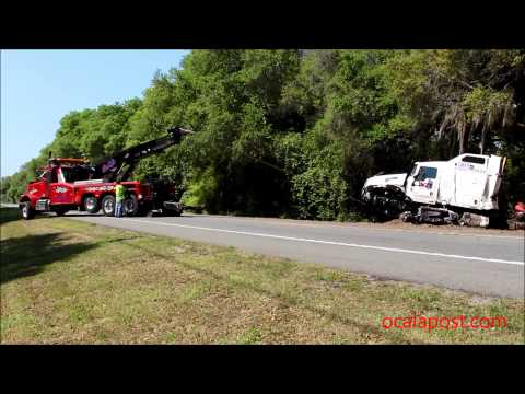 Fatal crash Semi and SUV; tow truck driver nearly injured when chain snapped