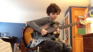 9 year old boy playing holiday by green day on guitar