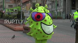 Bolivia: Police dress up as coronaviruses to warn of dangers of pandemic