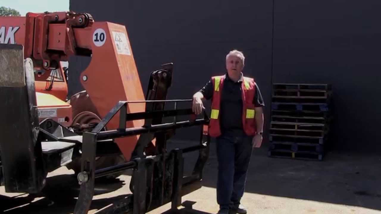 Rough terrain telehandler forklift moving a load youtube 1betcityfo Image collections