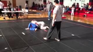 Judo girl taps boy out
