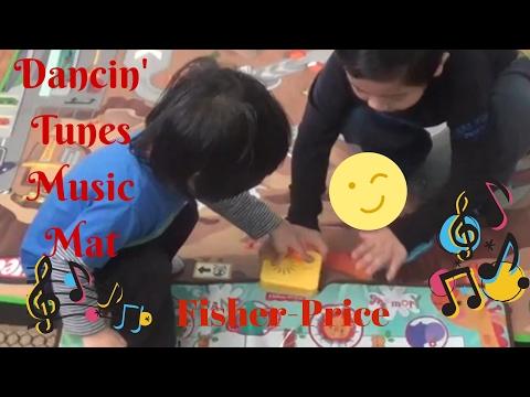 Playing with FISHER-PRICE DANCIN' TUNES MAT; Jaden singing