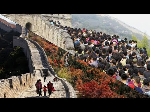 Tourists crowd scenic spots during China's national holidays