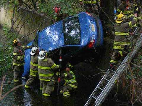 VIDEO/PHOTOS: Firefighters Rescue Driver After Car Falls Into Brook Off Route 208