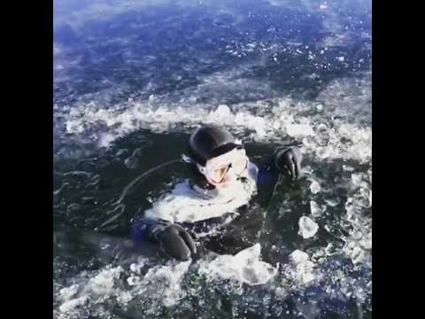 Man Dives into Frozen Lake