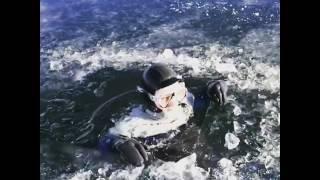 Man Dives into Frozen Lake