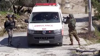 Israeli soldiers detain Palestinian ambulance at gunpoint during protest in the village of Beit Sira