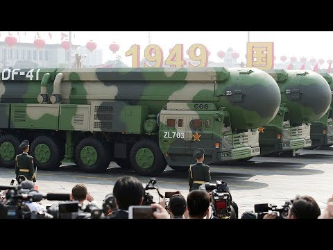Chinese president declares 'no force' can shake China as it unveils advanced new weapons