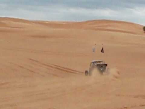 Dream Machines Of Texas Owner Larry Davis Does A Wheelie In His Sand Car