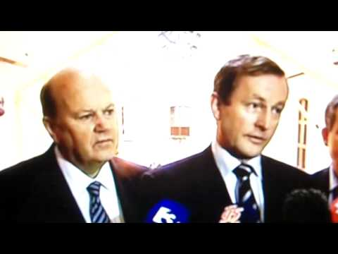 Michael Noonan's facial reaction to Enda Kenny's stance on 'the empty chair' and immigration.