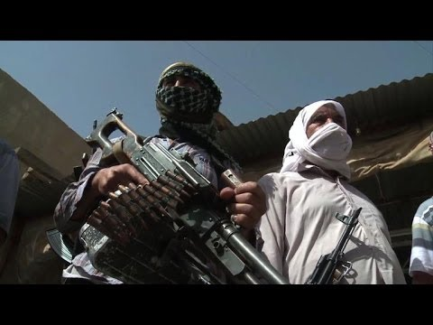 Embattled Iraqi Turkmen take up arms against militants